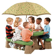 "3 years & up. Realistic sandstone and paver styled picnic table includes a removable 5' wide umbrella. Wide contoured benches will seat 6 kids comfortably. Rugged molded plastic is easy to clean and resists fading. Great for picnics, games and projects. Assembly required. 20 1/2""H x 43""W x 41""D. Does not meet CPSC or ASTM standards for public playgrounds."