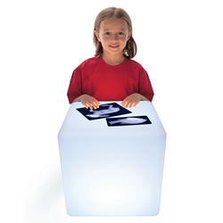 "3 years & up. This rugged light cube is portable, durable, and rechargeable. It even strobes, flashes, and changes color with the touch of a button! The cube is the perfect size for individual and small group play. Young children can stand or kneel at the cube and engage in focused, quiet play. The easy-to-clean surface is ideal for art and exploration activities both indoors and outdoors. Use the cube for examining transparent and opaque objects. Add interest to counting, sorting, sequencing, and building activities. Includes: cube, power source, remote control, and a teacher guide. Measures: 16""H x 16""W x 16""D."