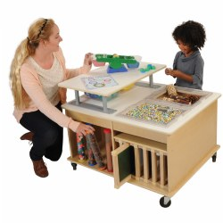 "4 years & up. This state-of-the-art interactive STEM table with 2 locking casters offers multiple, hands-on STEM learning experiences. Young learners can engage in a variety of child-guided experimental and investigative activities. The six activity blocks fit perfectly into either of the two recessed areas and give children the opportunity to experiment with magnets, heat, magnification, and more! Plenty of storage to accommodate a variety of supplies and specimens. Bins included! Measures 30""H x 36""L x 30""W. Contents shown are not included."