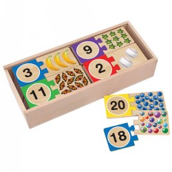 4 years & up. Great for matching and counting skills! Match these wooden puzzle pairs to make mastering numbers fun. Groups of objects illustrate numbers 1-20, and the puzzles are self-correcting--each piece has only one match that fits--so children can play independently and be successful. The full-color pictures feature familiar objects. Includes 40 wooden pieces in a wooden storage box with a slide-in lid.