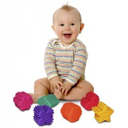6 months & up. Soft and squeezable, these fun shapes with their knobby surface will stimulate the senses as toddlers squeeze the pliable material in their hands. Shapes include a heart, flower, hexagon, diamond, clover, and star.