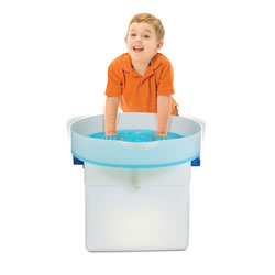 "3 years & up. Explore a whole new range of sensory fun with the Sensory Table! Designed to produce simultaneous tactile, auditory and visual effects, the Sensory Table can be placed on top of the Light Cube (item # 27915 - sold separately) to add visual interest or use on top of other surfaces. Place water, sand or other sensory materials inside the tray. Turn the tray for vibration and watch the materials shake, sift and glide about! The tray is water-safe and easy to clean. Tray comes with rechargeable batteries and an A/C adapter. Includes: 1 sensory tray up to 21.5 x 8"" and guide."