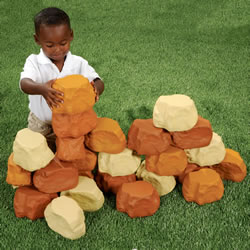 "3 years & up.  Build to new heights with this fantastic collection of realistic pretend rocks! Whether you are building a mountain or designing a fort, the possibilities are endless. This 25-piece set of lightweight, weather-proof foam rocks stack easily for endless creative building projects and harrowing adventures. Perfect size for encouraging gross motor development. Bricks measure at 8""L x 3 1/2""W x 2""D."