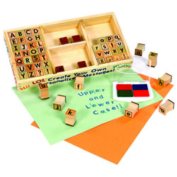 "Our alphabet stamp set contains 56 block style stamps in upper and lowercase, and punctuation marks. Children can imprint their names on art work, books, make stationary, or write a word or sentence. Includes a 4 color stamp pad with washable, non-toxic ink and a wooden storage container too! Container measures 10""L x 8""W x 2""D."