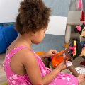 Alternate Thumbnail Image #3 of Fastening Learn To Dress Doll - Female with Yellow Headband