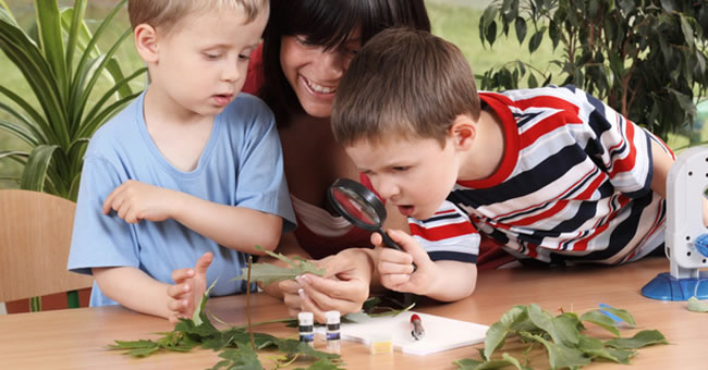 Children and Teacher with magnifying glass