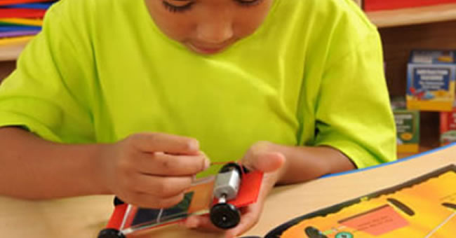 Child assembling toy car