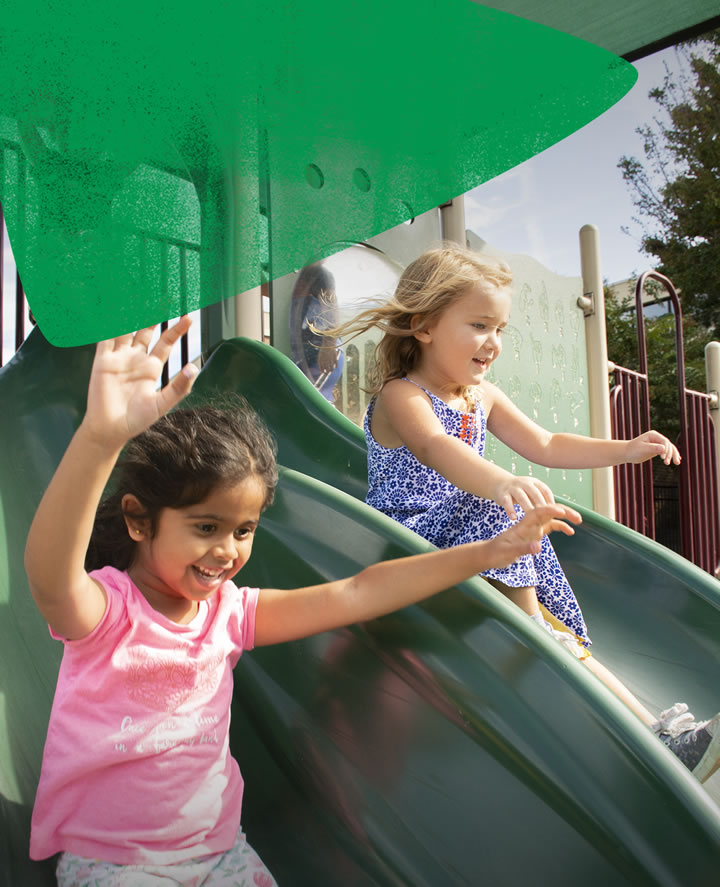 Two children playing on slide - outdoor learning